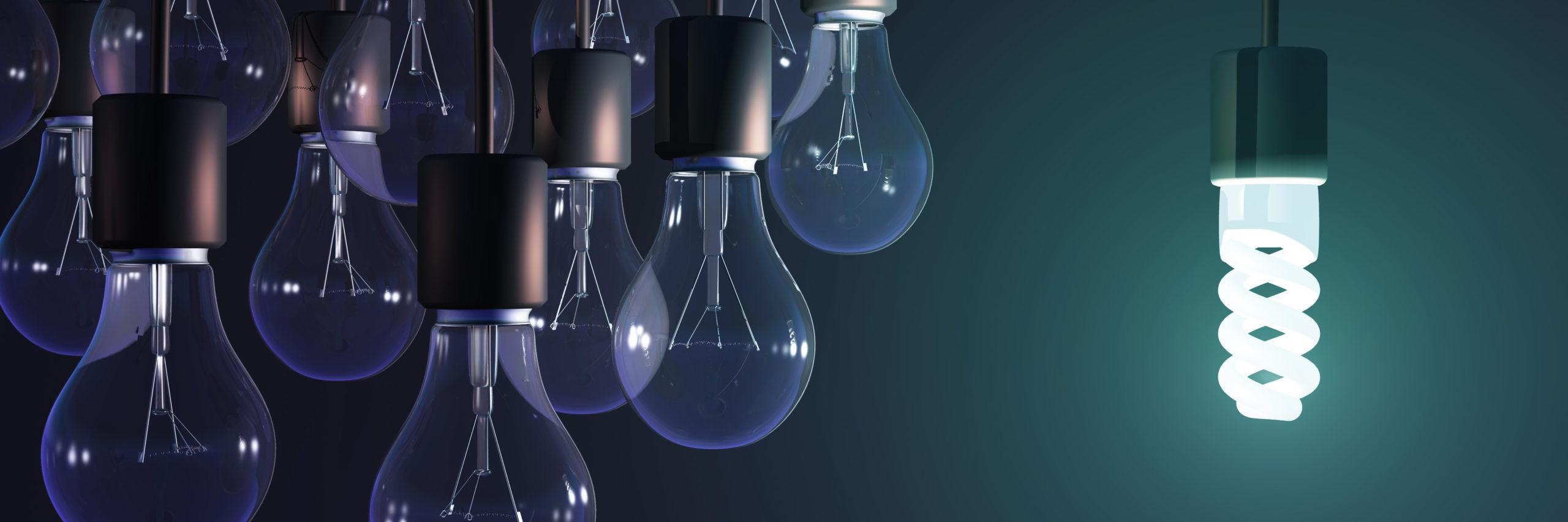 energy-saving lamp among the gray bulb - Illustration