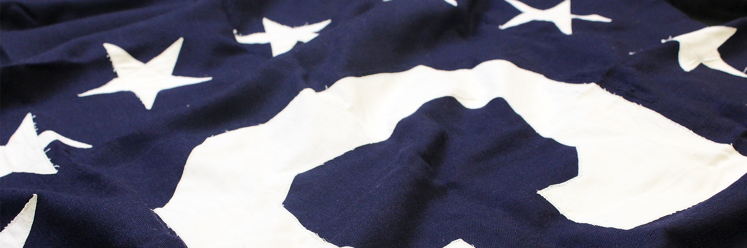 Consular Affairs Flag, white C surrounded by 13 white stars on a field of blue