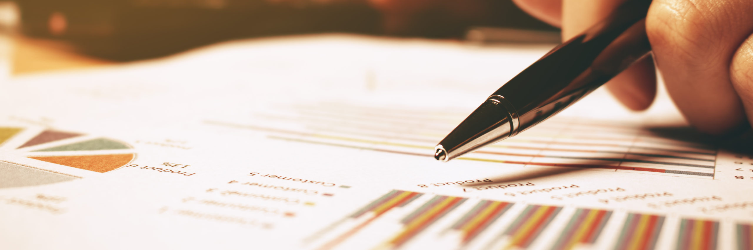 Hand woman holding pen pointing on summary report chart and calculate finance. - Image
