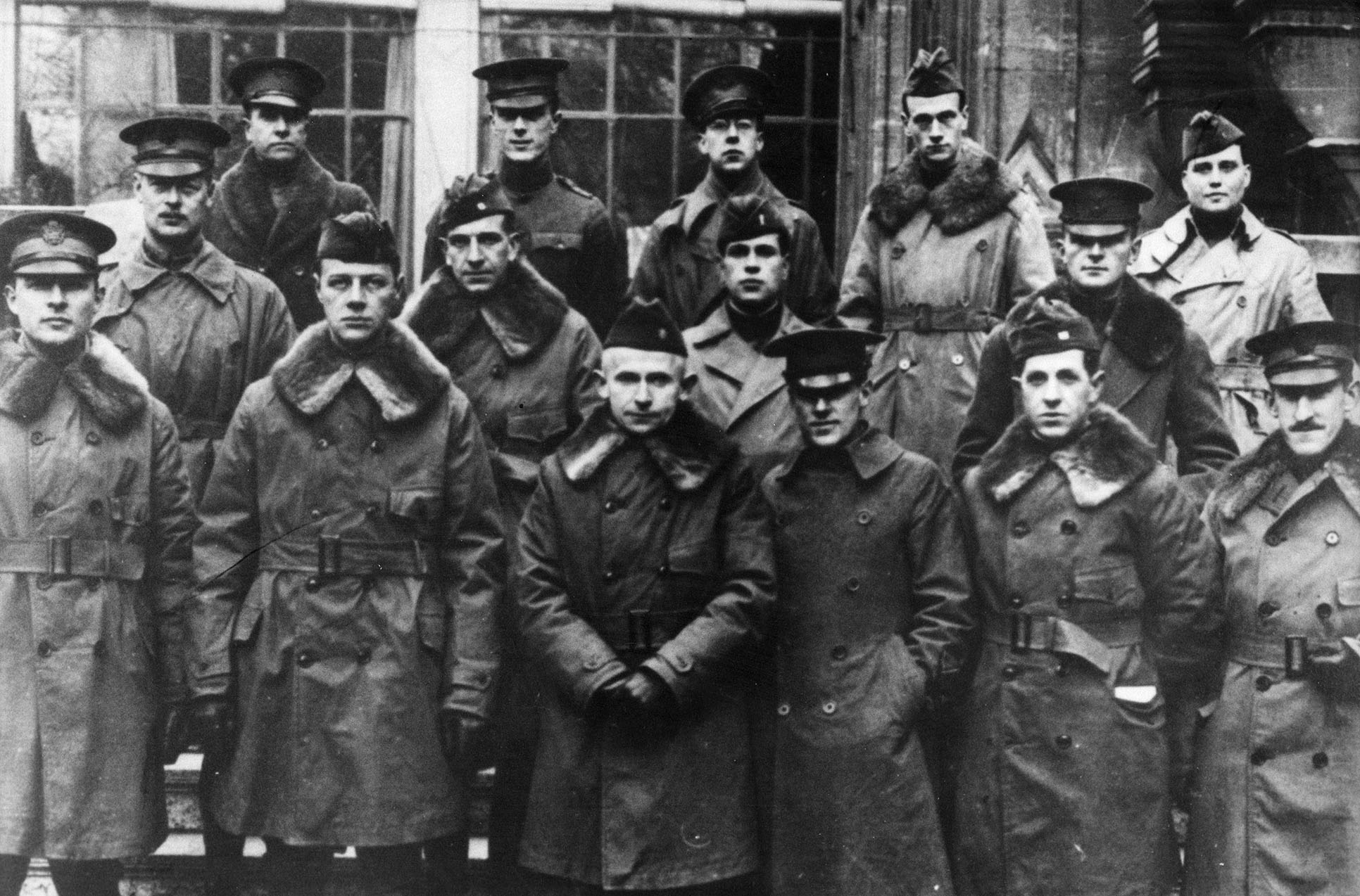 The 15 U.S. Army Officers who served as the first Diplomatic Couriers. They were assigned to the U.S. Embassy in Paris, France in 1918. Courier founder, Major Amos J. Peaslee (center) is flanked by the first group of couriers. The U.S. Army's Silver Greyhounds were assigned to the U.S. Embassy in Paris in 1918 as part of the Delegation to Negotiate Peace, becoming the first dedicated group of diplomatic couriers in U.S. history. (U.S. Department of State photo)
