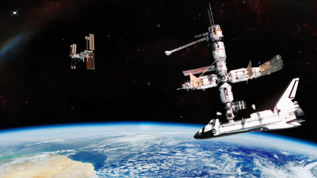 Panoramic view artist expression of International Space Station activity over an Earth with a solar milky stars behind it - Elements of this image furnished by NASA. - Image