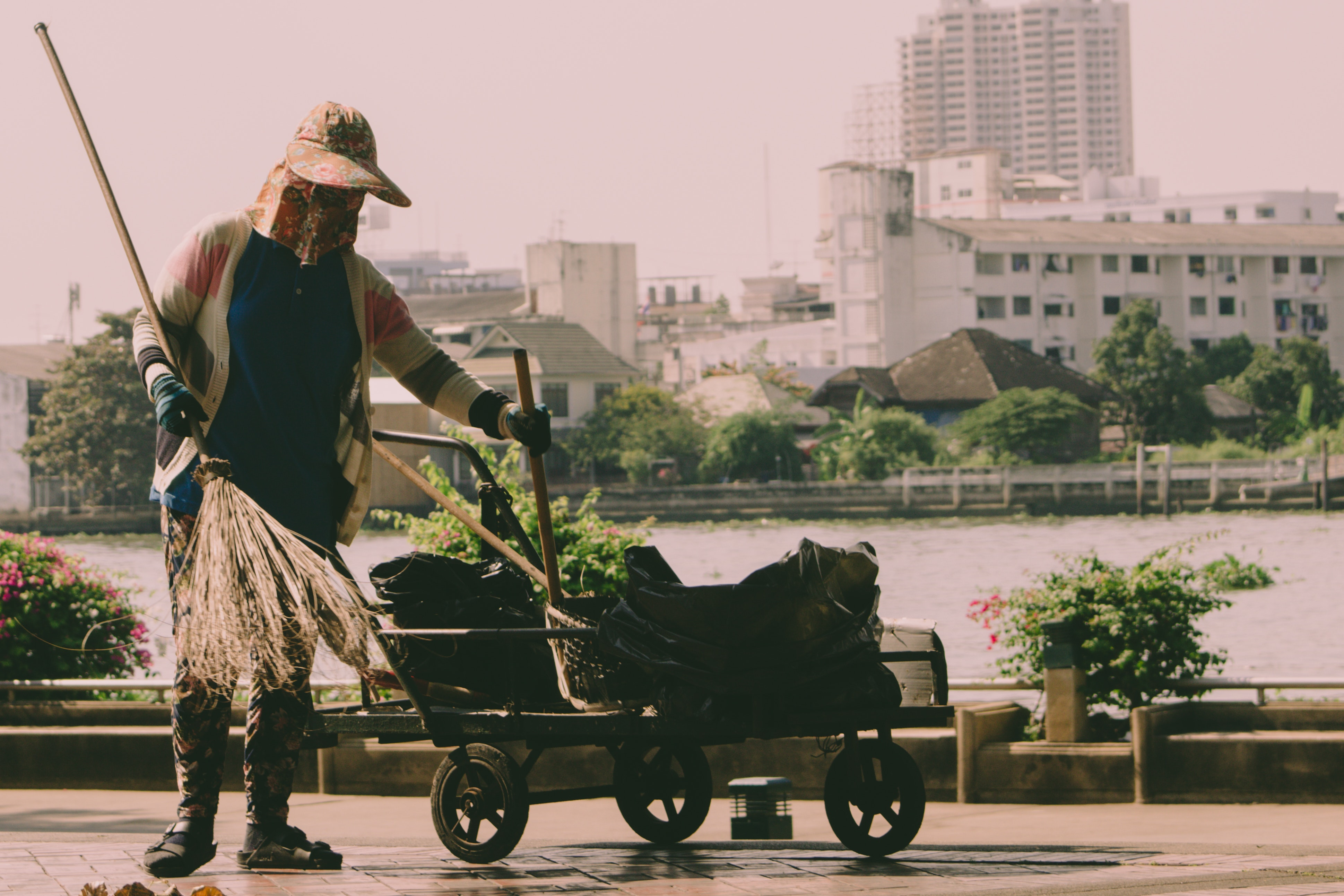 Woman sweeping on a patio. (Bas Masseus; 2008)