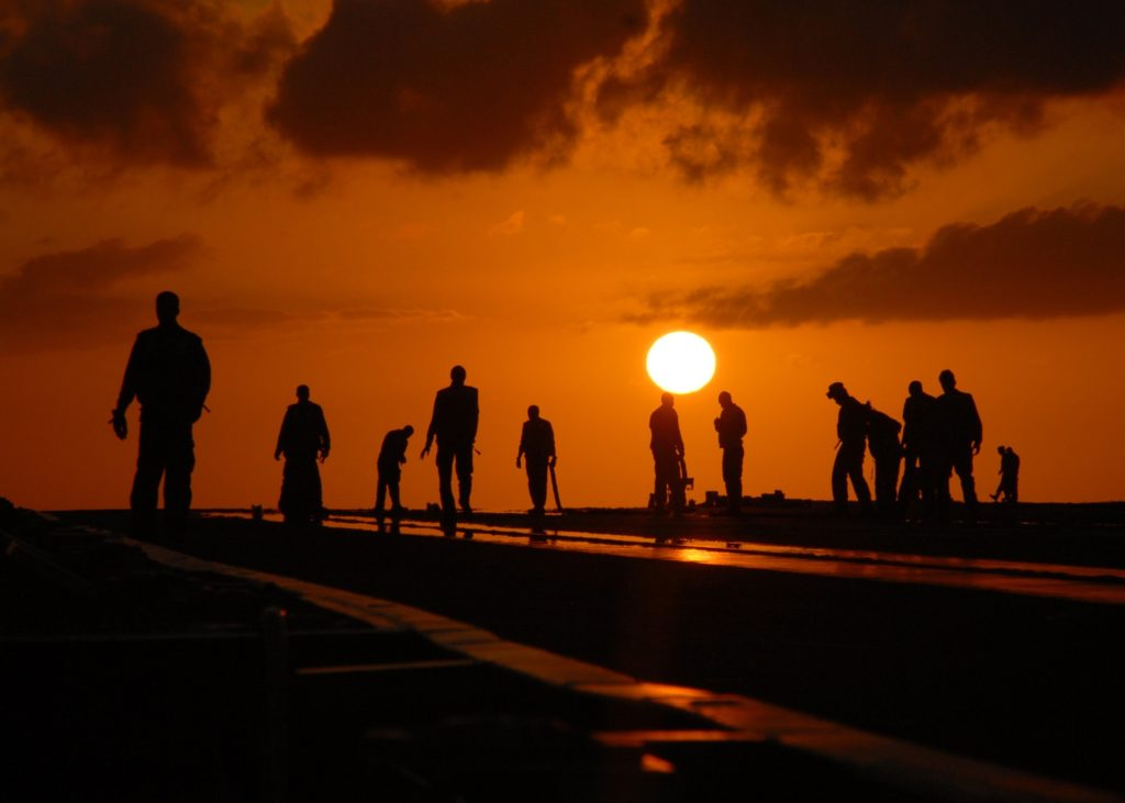 Silhouette of workers at sunset. (Pixabay; 2004)