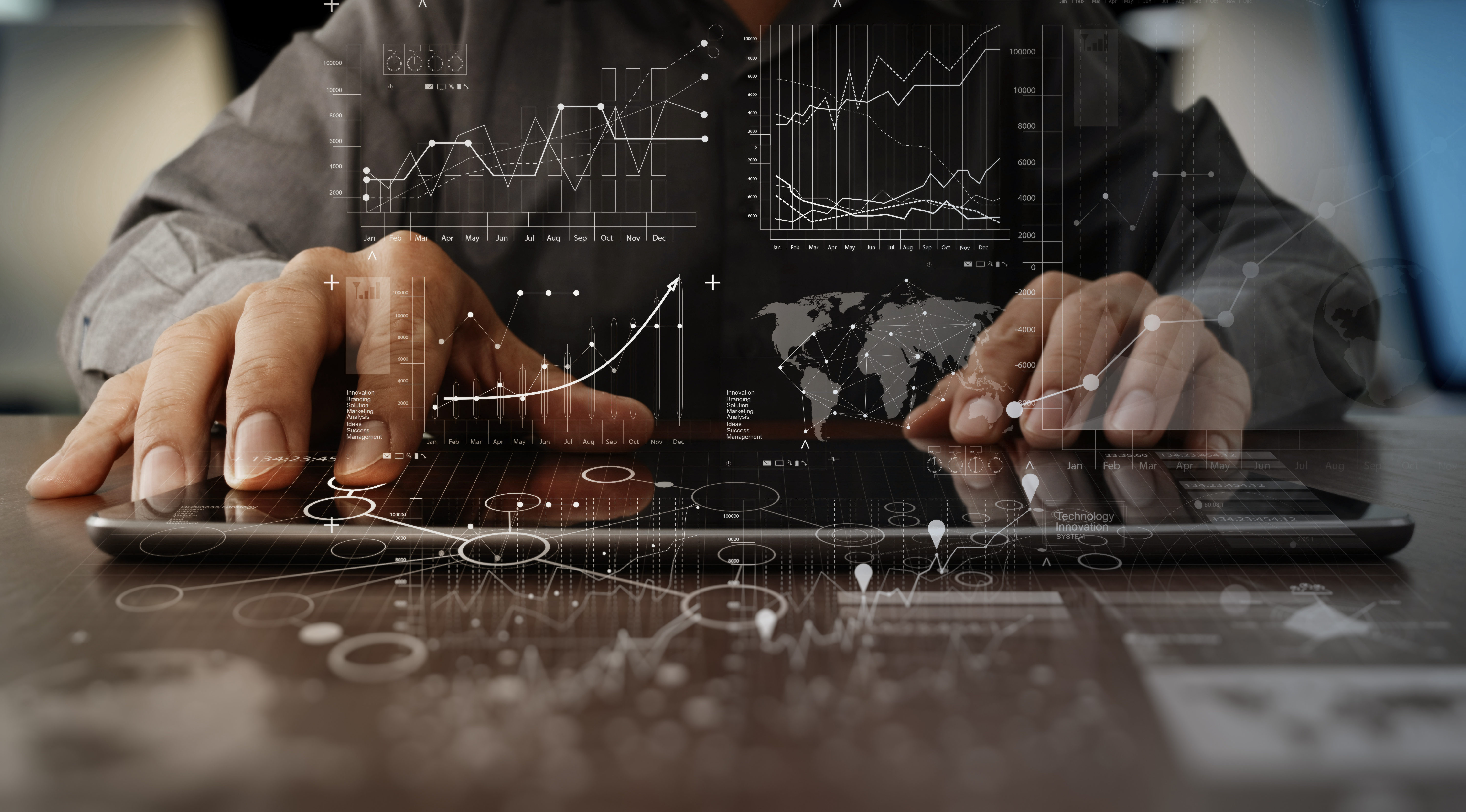 businessman hand working on laptop computer with digital layer business strategy and social media diagram on wooden desk - Shutterstock Image
