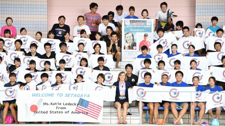U.S. Olympic swimmer Katie Ledecky poses for a photo with youth during a swimming clinic in Satagaya, Japan.