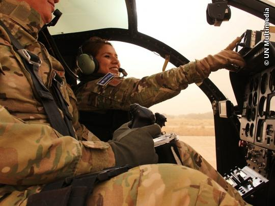 Salvadoran Captain Sandra Hernandez flies her MD-500E helicopter over Mali. She is the only female pilot to fly armed helicopters as part of the MINUSMA mission.