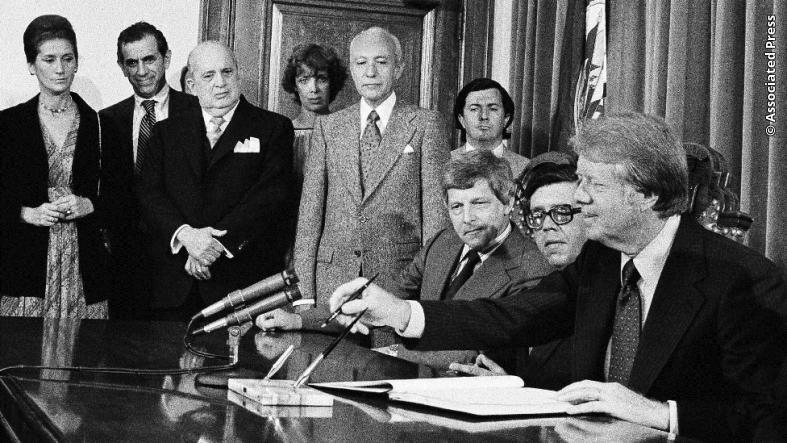 President Jimmy Carter prepares to sign the American Convention on Human Rights at the Pan American Building in Washington, DC, on June 1, 1977.