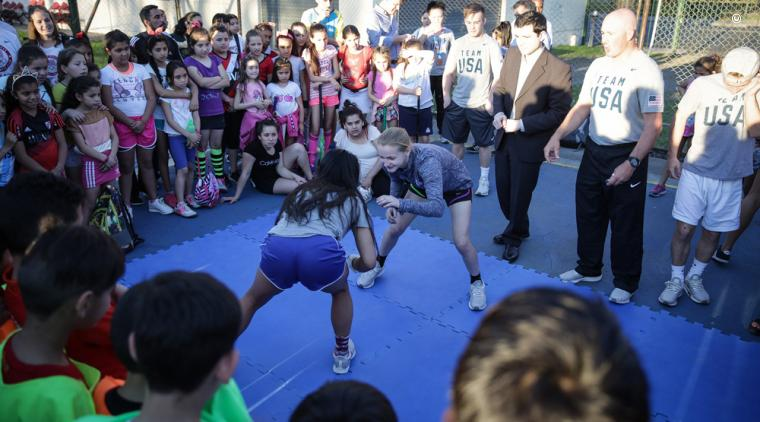 Two TeamUSA Olympic athletes participate in a wrestling demonstration for Argentine youth at Polideportivo Pereyra on October 16. (U.S. Embassy Buenos Aires/ Jorge Gomez)