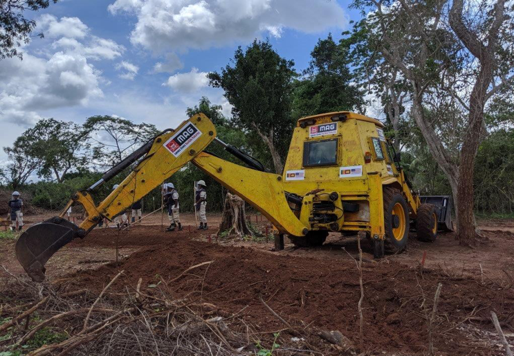 A MAG Mechanical Operator demonstrates how armored heavy machinery is used to prepare ground for demining operations by clearing dense vegetation. (Photo courtesy of the State Department)