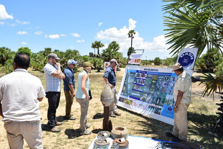 The author receives a briefing on the types of contamination found in a specific hazard area. (Photo courtesy of DASH)