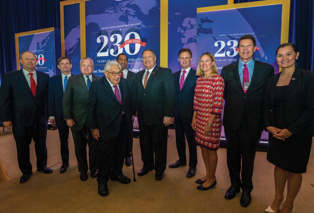 Photo showing Secretary Pompeo posing for a photo with former Secretary Kissinger and Senior Staff at the 230th Anniversary Celebration in Washington, D.C., July 29, 2019. [Department of State]