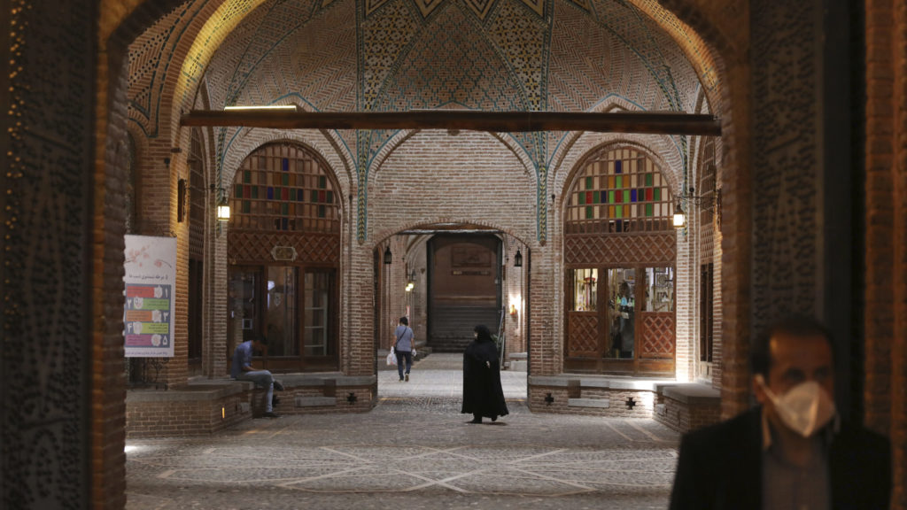 People walk through a part of the mostly empty of the Qazvin old traditional bazaar northwest of the capital Tehran Iran, April 22, 2020. (AP Photo)