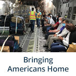 """""""Bringing Americans Home"""" subheader with photo of Embassy Panama City Staff Assist U.S. Citizens Returning Home (Flickr, State Department Photo)"""