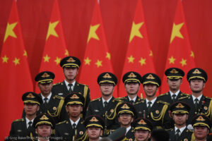 "Members of a military band stand on stage after an award ceremony in Beijing's Great Hall of the People Sunday, Sept. 29, 2019. Chinese President Xi Jinping awarded medals and honorary titles to an array of both domestic and international ""heroes"" on Sunday, including a centenarian Canadian educator, and a former French prime minister. (Greg Baker/Pool Photo via AP)"