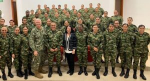 The author (center), joined by U.S. Southern Command Commander Admiral Craig S. Faller, Colombian Army General Luis Navarro and Colombian Army Major General Eduardo Zapateiro, meets with a group of active duty women soldiers from the Colombian Army. (Photo courtesy of U.S. SOUTHCOM)