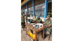 Armed Forces of the Democratic Republic of the Congo ( personnel operate a weapons marking machine provided by the United States. (Department of State photo)