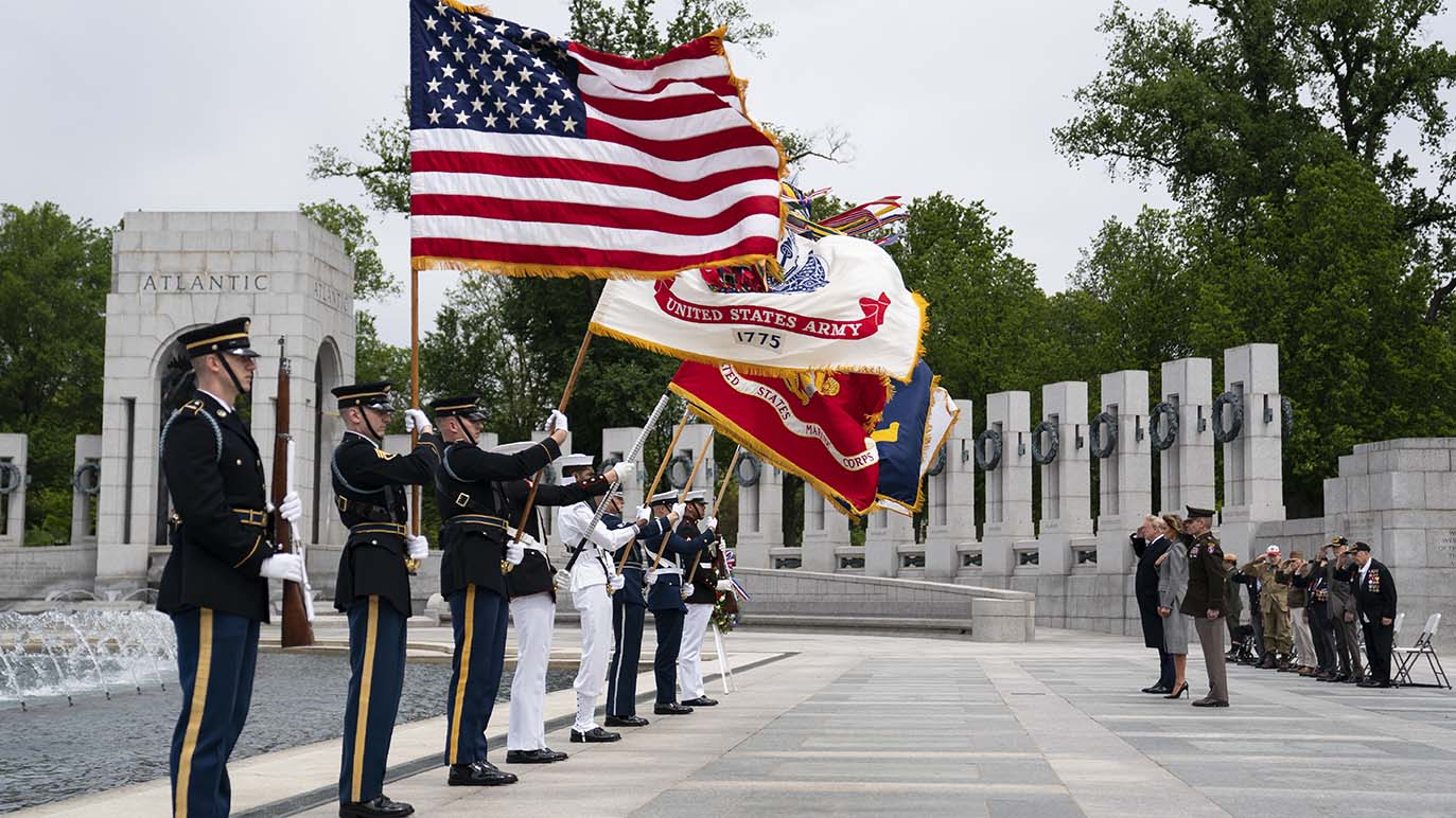 President Donald Trump and first lady Melania Trump participate in a wreath laying ceremony at the World War II Memorial to commemorate the 75th anniversary of Victory in Europe Day, Friday, May 8, 2020, in Washington. (AP Photo/Evan Vucci)