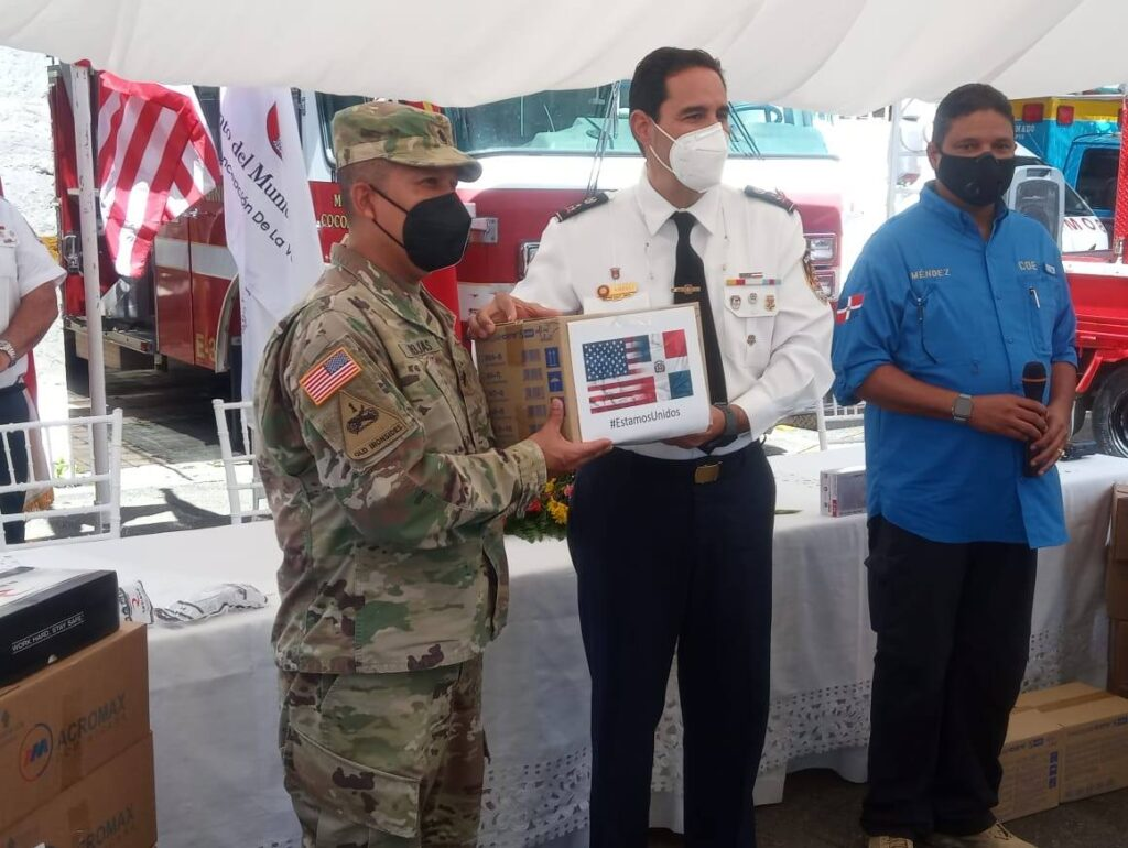 SOUTHCOM HAP donation of personal protective equipment to the La Vega Fire Department and Civil Defense to supporting the fight against the pandemic. The donation consisted of 2,750 surgical masks, 963 reinforced masks, 435 clear safety glasses, 10,000 shoe covers, 300 body suits with boots and hood, 400 bottles of hand sanitizer, and 3,000 nitrile gloves. (U.S. Embassy Dominican Republic photo)