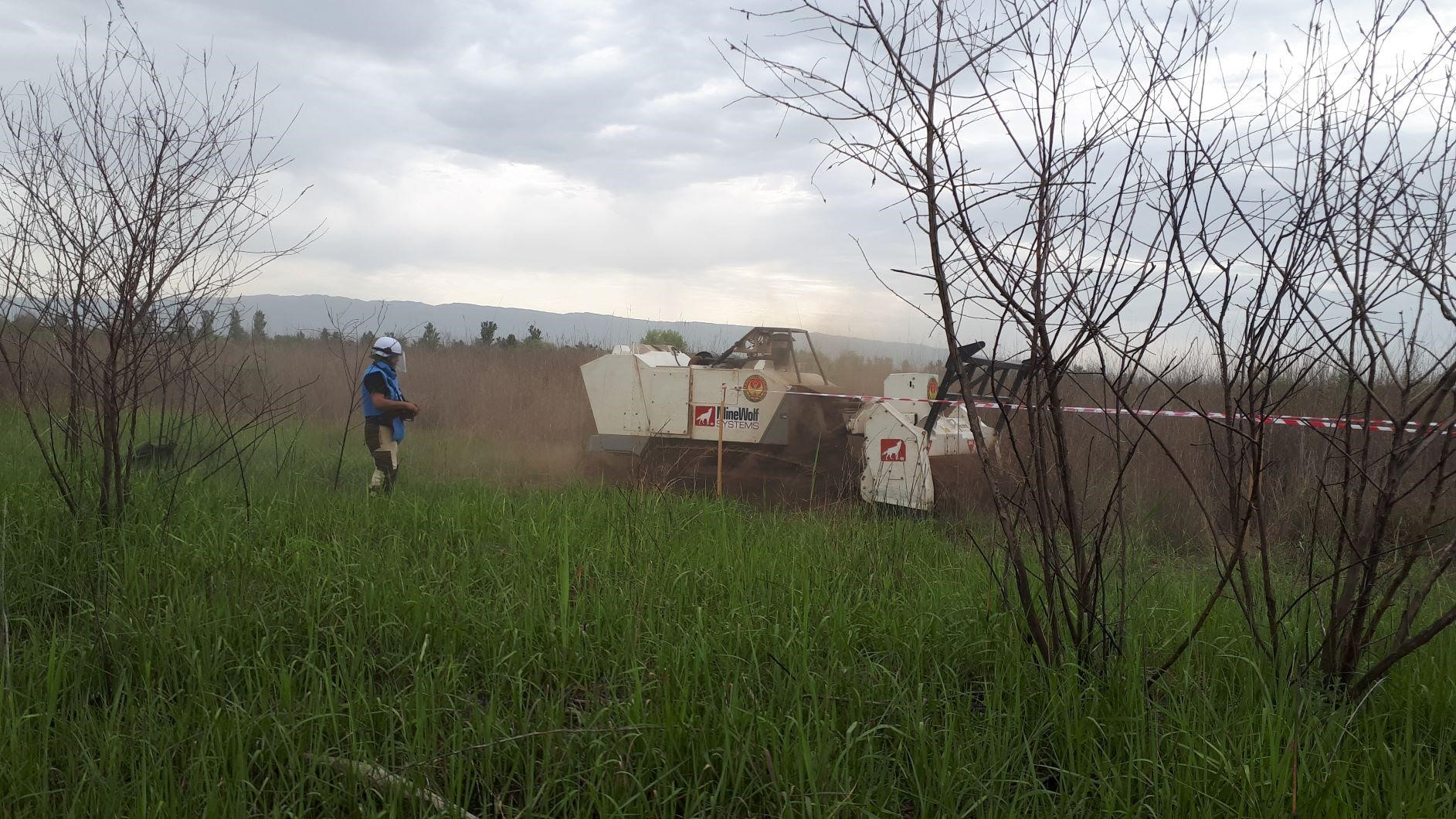 Mini-Mine Wolf machine operator, Firuz Asadbekov, conducting initial accreditation activities with the mine wolf machine in the Panj District, Khatlon region, located along the Tajik-Afghan border. (Photo courtesy of Norwegian People's Aid (NPA)