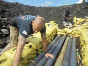 Mines Advisory Group staff prepare obsolete ammunition for bulk demolition near Goma, North Kivu. (Photo courtesy of MAG)