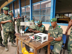 FARDC personnel operate a weapons marking machine provided by the United States, part of an ongoing effort to improve munitions stockpile accountability. (Department of State photo)