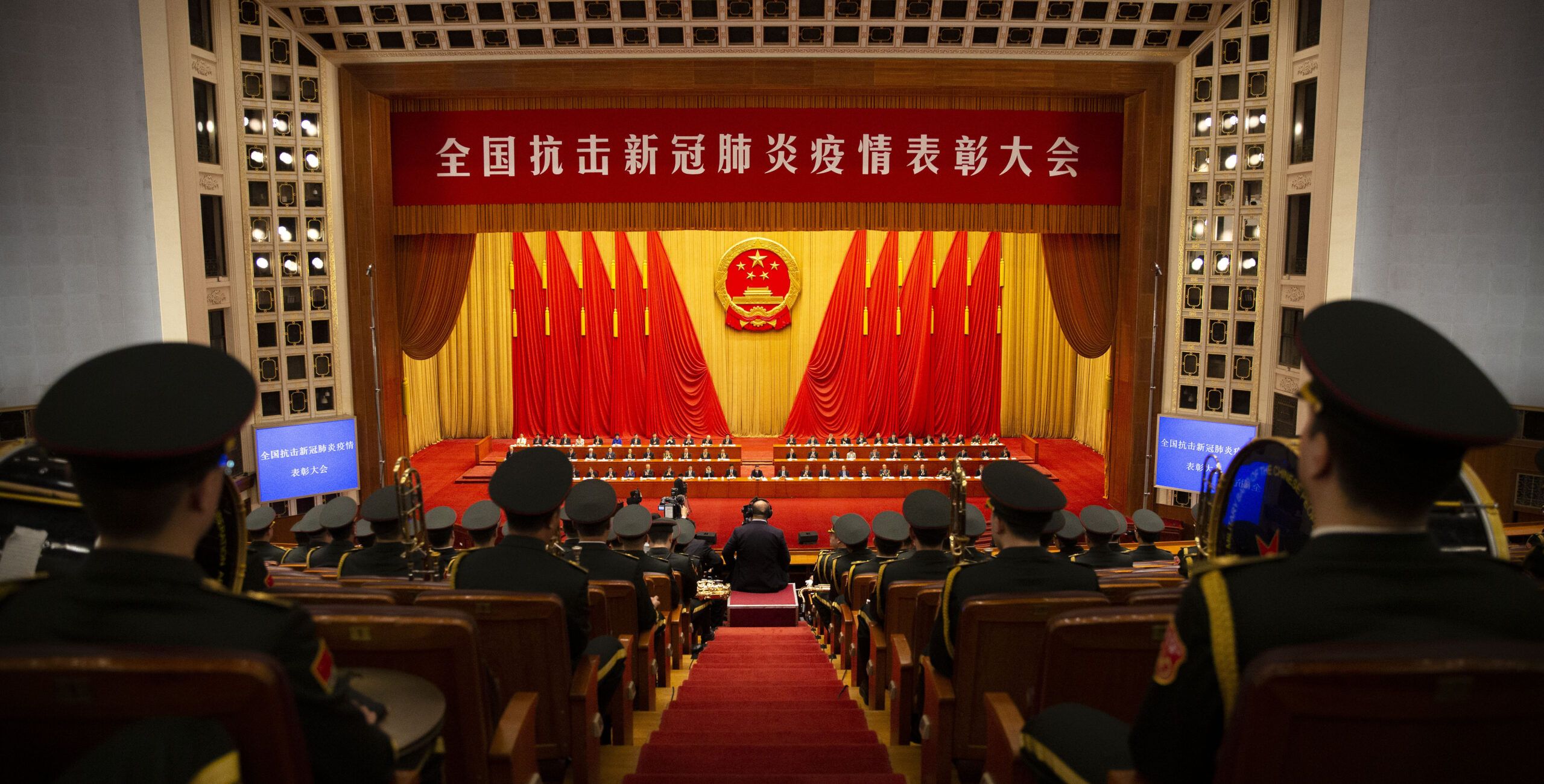 Members of Chinese military band watch an event to honor some of those involved in China's fight against COVID-19 at the Great Hall of the People in Beijing, Tuesday, Sept. 8, 2020. Chinese leader Xi Jinping is praising China's role in battling the global coronavirus pandemic and expressing support for the U.N.'s World Health Organization, in a repudiation of U.S. criticism and a bid to rally domestic support for Communist Party leadership. (AP Photo/Mark Schiefelbein)