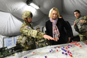 U.S. Army Lt. Col. L. Andrew Zartman, the commanding officer the 1st Squadron, 152nd Cavalry Regiment, 76th Infantry Brigade Combat Team, 38th Infantry Division, Indiana Army National Guard, gestures toward a battle map while speaking with U.S. Ambassador Bridget Brink, the ambassador to Slovakia, at Lest military training center, Slovakia, Nov. 8, 2019. (U.S. Army photo)