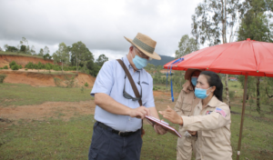 Ambassador Haymond speaks with a MAG survey team member. (Photo courtesy of U.S. Embassy Vientiane)