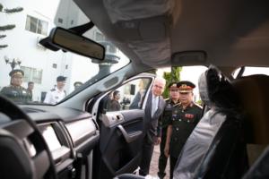 U.S. Ambasador Peter Haymond and Major General Aesamay Leuangvanxay inspect the interior of the ambulances. (U.S. Embassy Vientiane photo)