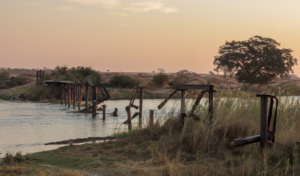 Landmines continue to block access to damaged critical infrastructure including this bridge over the Cuito River, denying local residents a vital lifeline to services and markets. (Photo courtesy of The HALO Trust)