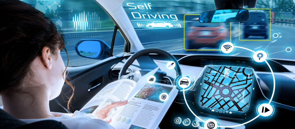 young woman reading a book in a autonomous car. driverless car. self driving vehicle. heads up display. automotive technology. [shutterstock]