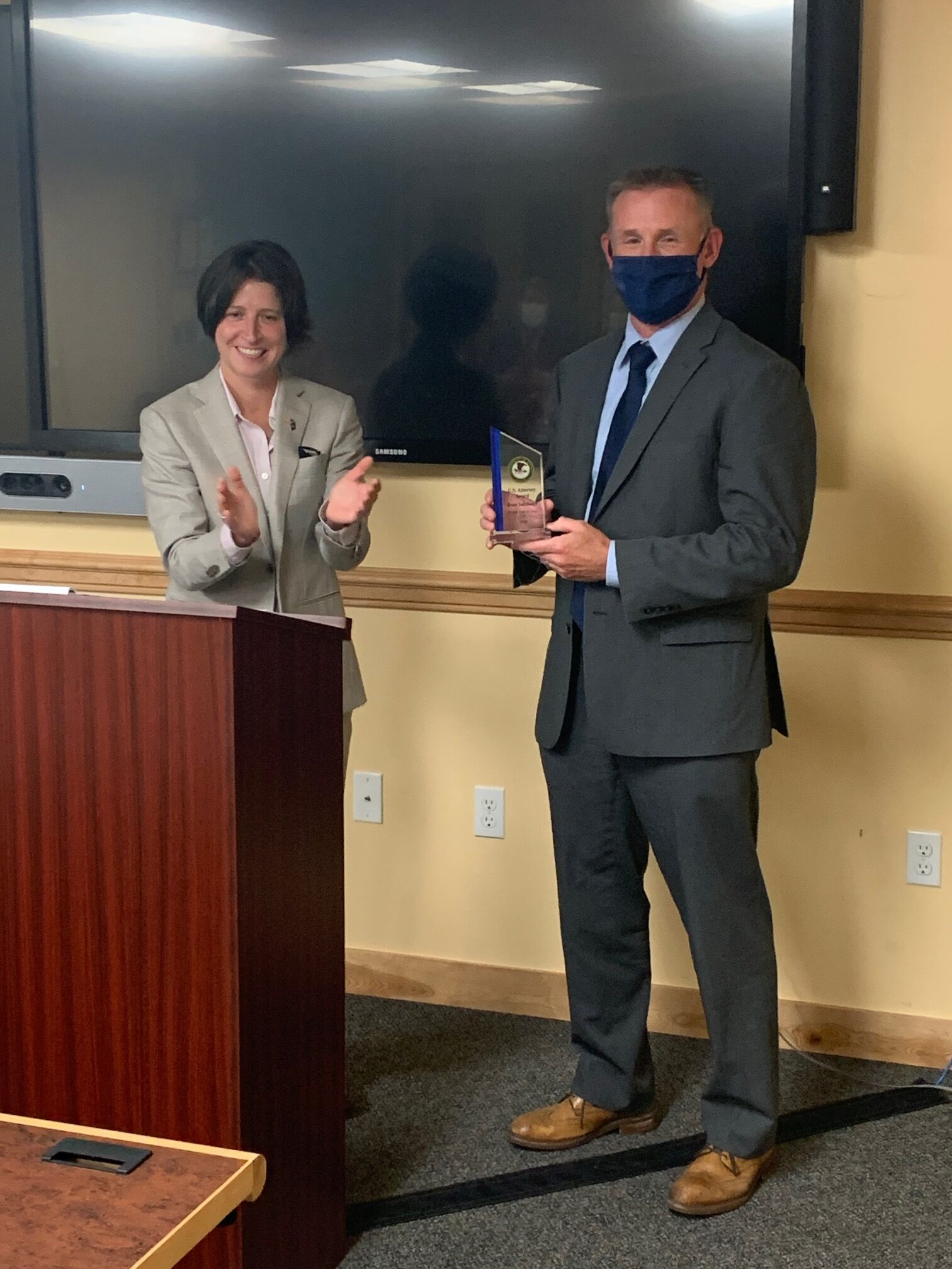 US Attorney Christina Nolan presenting SA Sultzbaugh with award (Department of State photo)
