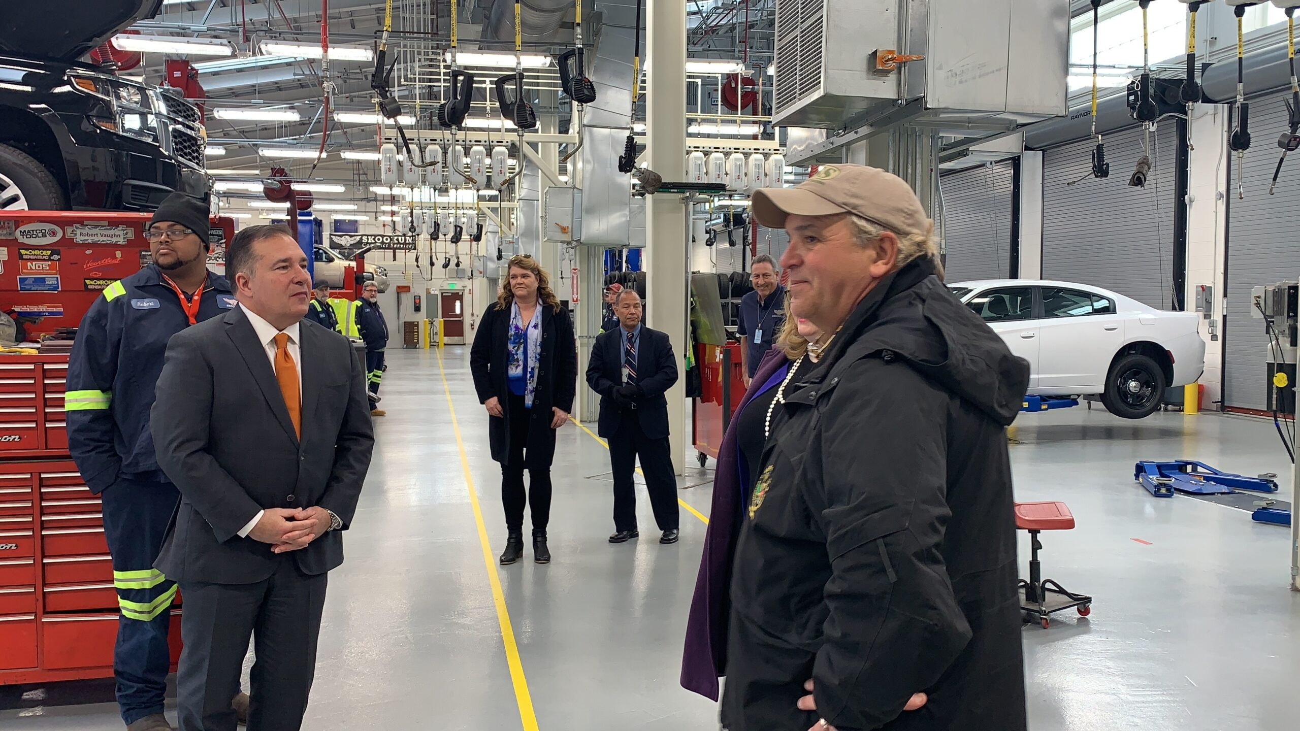 Maner Lawton (right foreground), chief, Driver Training Unit, Diplomatic Security Service's (DSS) Foreign Affairs Security Training Center (FASTC) and staff conduct a tour of the Vehicle Maintenance Facility for then Assistant Secretary for Diplomatic Security Michael Evanoff (left foreground) and other federal and state officials during the FASTC inauguration in November 2019. The 17,000 sq. ft. facility contains 14 vehicle bays and allows for DSS to provide on-site vehicle maintenance and repairs, Blackstone, Virginia. (U.S. Department of State photo)