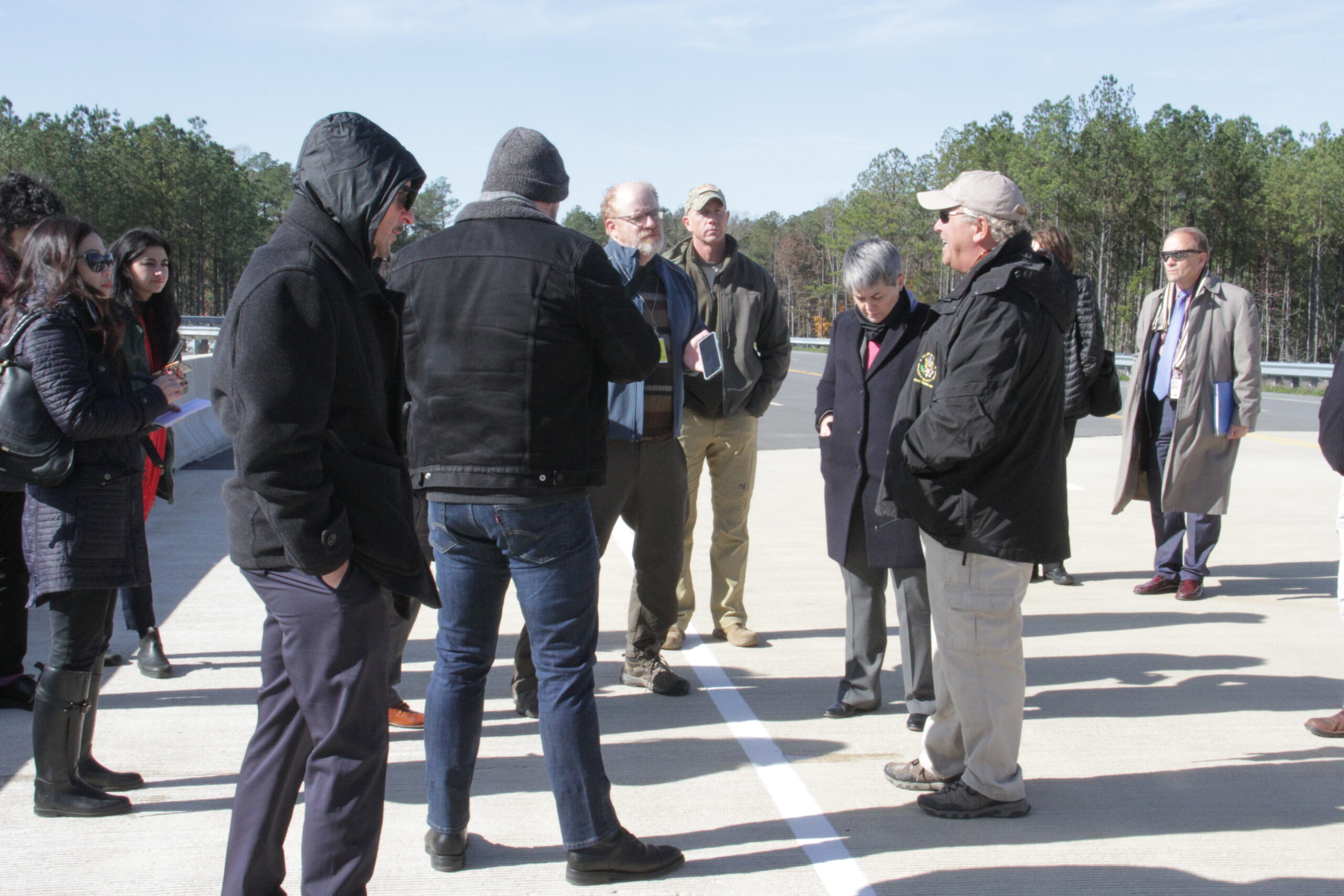 Maner Lawton, chief, Driver Training Unit, Diplomatic Security Service's (DSS) Foreign Affairs Security Training Center (right foreground, white cap), briefs reporters and DSS officials on DSS driver