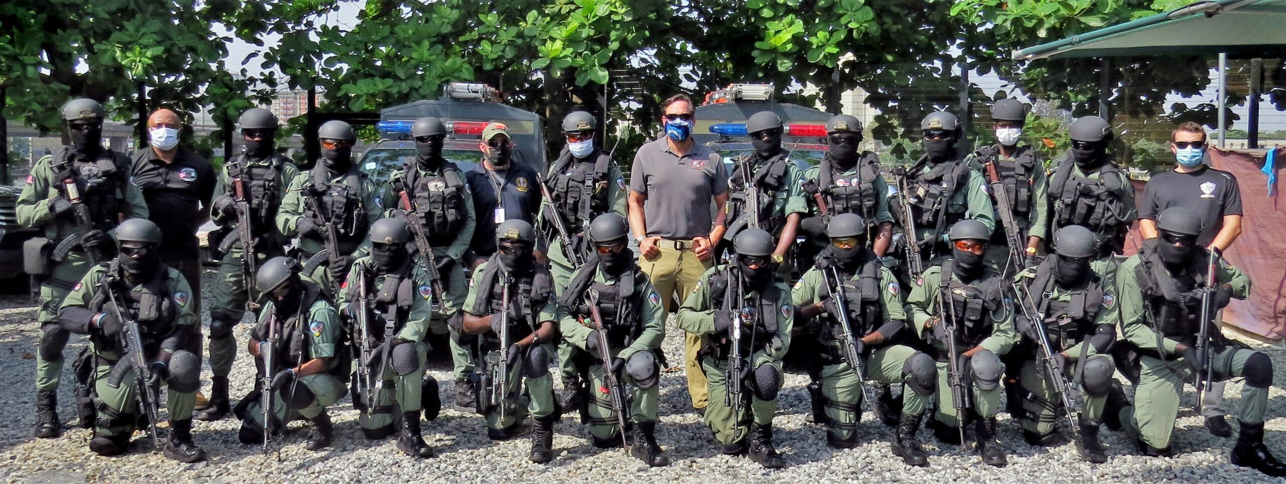 Police with the Lagos, Nigeria, SPEAR team pose alongside U.S. Diplomatic Security Service counterparts in November 2020. The police are part of a Special Program for Embassy Augmentation Response (SPEAR) team, assigned to protect U.S. diplomatic facilities and personnel. SPEAR teams are quick-response forces trained and funded by the Diplomatic Security Service's Office of Antiterrorism Assistance (ATA). (Department of State photo)